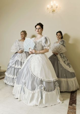 secular: Picture of three young women in ball gowns