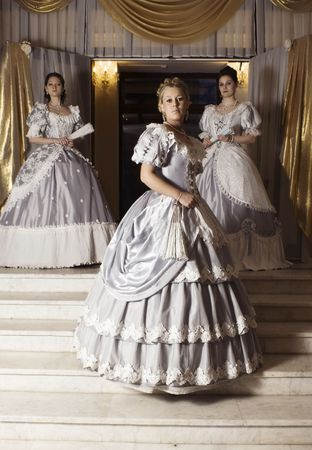 costume ball: Picture of three young women in ball gowns