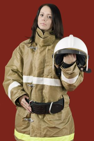 Picture of a girl in fireman uniform photo