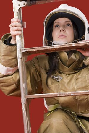 Picture of a girl in fireman uniform upstairs photo