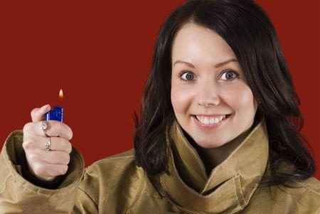 be careful: Girl in fireman uniform warns: Be careful with fire! Stock Photo