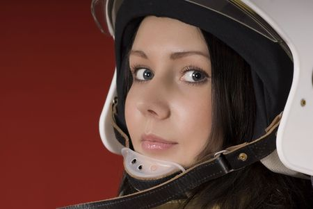 Portrait of a young girl in a fireman`s helmet photo