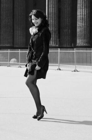 Beautiful italian woman straightens her stockings photo