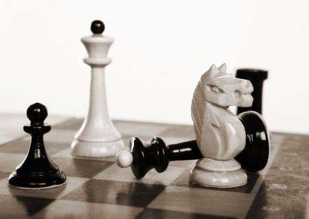 chessmen: Game over. Picture of the chessmen on a chessboard Stock Photo