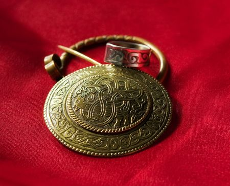 slavic: Jewels with ancient Slavic designs on a red background
