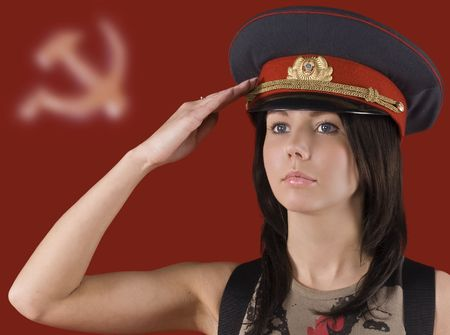 soviet: The pretty girl in a militia cap on the Soviet symbols background