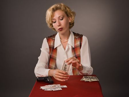 The pretty woman with cards on a grey background photo