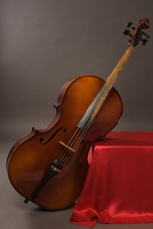 picture of the old cello on a gray background photo