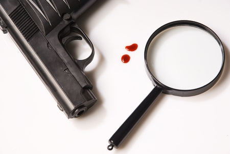 firearm: magnifying glass, blood drops and pistols over white background   Stock Photo