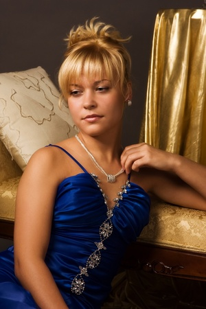 Aristocratic lady in a dark blue dress in a luxurious boudoir Stock Photo - 8973679