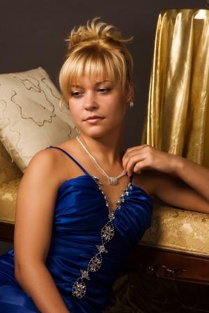 Aristocratic lady in a dark blue dress in a luxuus boudoir Stock Photo - 8973679