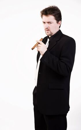 Business man in black suit with cigar photo
