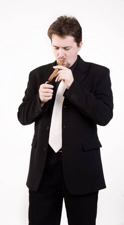 Business man in black suit smokes a cigar photo