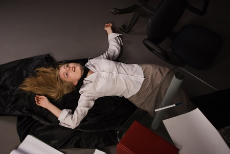 Srangled college girl lying on the floor Stock Photo - 8973565