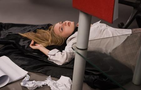 Srangled college girl lying on the floor Stock Photo - 8973588