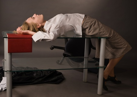 Dead college girl lying on the table Stock Photo - 8973570