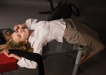 Dead college girl lying on the table photo