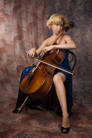 cellist: Pretty woman in evening dress playing cello