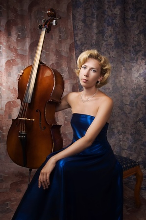 Attractive woman in evening dress with cello Stock Photo - 9058207
