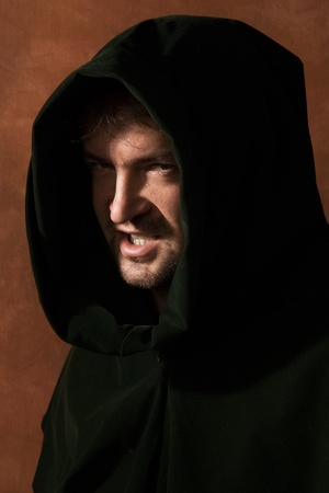 Portrait of a man in a medieval hood  版權商用圖片