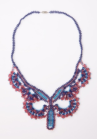 Decorative bead necklace on a white background photo
