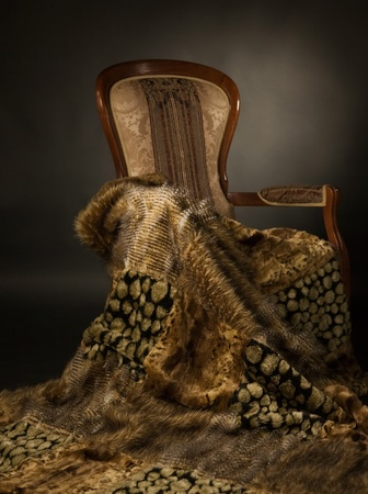 Elegant chair with a fur blanket  photo