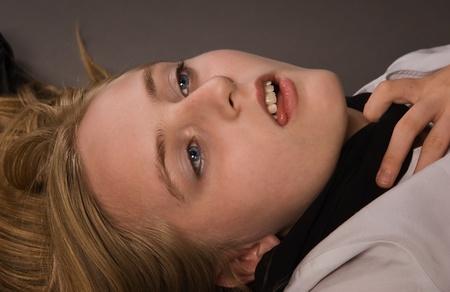 to strangle: Crime scene. Strangled girl lying on a floor