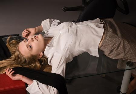 assassination: Crime scene. Lifeless girl lying on a table Stock Photo