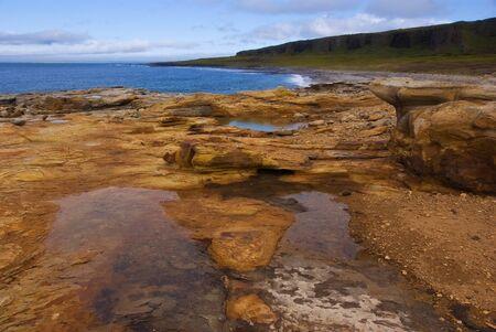 Yellow stones on the Arctic Coast. Northern Russia, Kola peninsula Stock Photo - 9058346