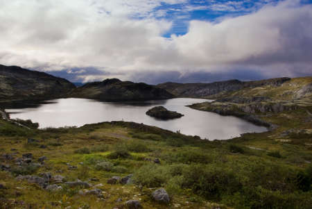 Mountain lake on the ridge Musta Tunturi. Kola Peninsula, Arctic Russia. HDR Image photo