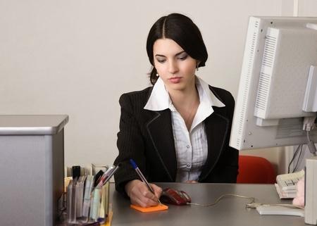 Portrait of the pretty secretary in a office Stock Photo - 9058384