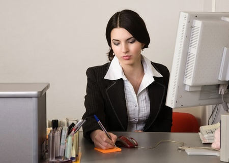 Portrait of the pretty secretary in a office Stock Photo - 9058384