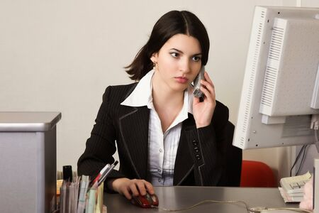 Portrait of the pretty secretary in a office Stock Photo - 9058400