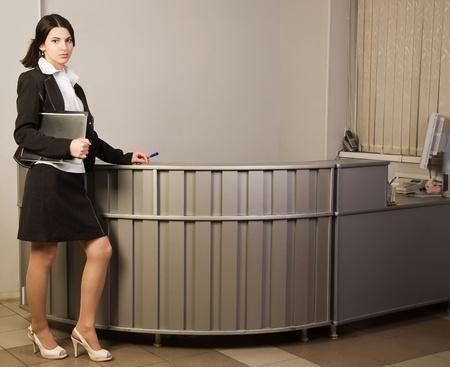 Portrait of the pretty secretary in a office Stock Photo - 9058368
