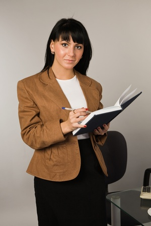 Happy successful business woman in a office Stock Photo - 9058397