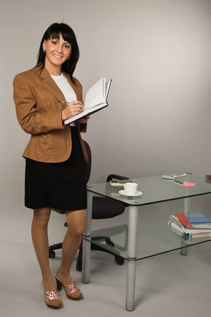 Happy successful business woman in a office Stock Photo - 9058365