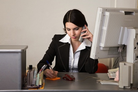 Portrait of the pretty secretary in a office Stock Photo - 9058399