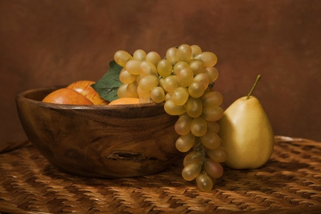 Picture of a still-life with fruit in a wooden dish photo