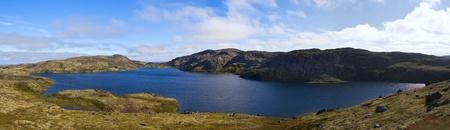 cusp: Mountain lake on the ridge Musta Tunturi. Kola Peninsula, Arctic Russia Stock Photo