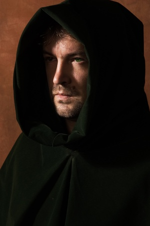 Portrait of a man in a medieval hood photo