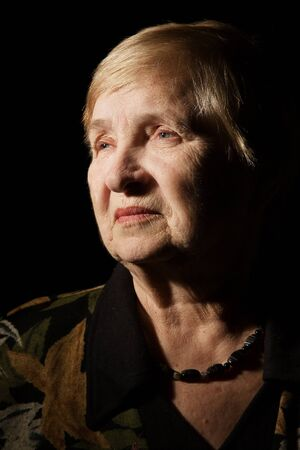 Portrait of a lovely old woman over black photo