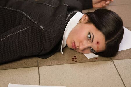 Face of the lifeless killed businesswoman in a office Stock Photo - 9125660