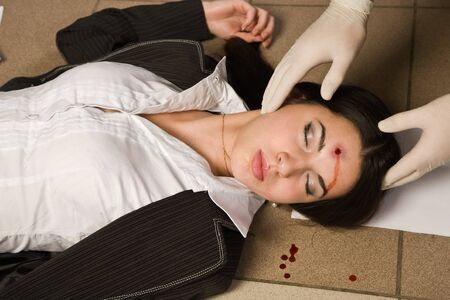 Forensic expert collecting evidence in a crime scene around a dead businesswoman Stock Photo - 9125651