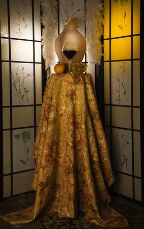 Jug, wine glass, grape in a luxurious interior  photo