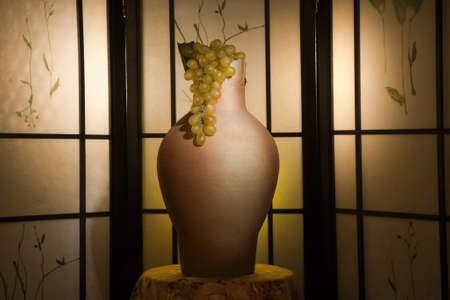 Jug with grape in a luxurious interior   photo