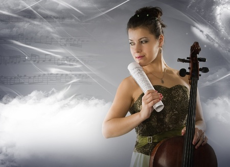 Beautiful woman with cello on a space background photo