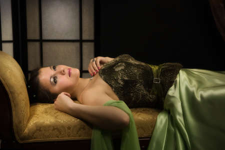 Elegant aristocratic lady in a luxurious boudoir photo