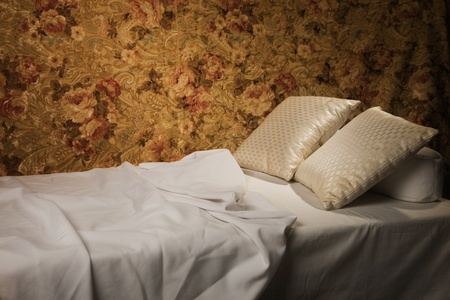 Messy luxurious bed with pillow and quilt cover Stock Photo - 9125649