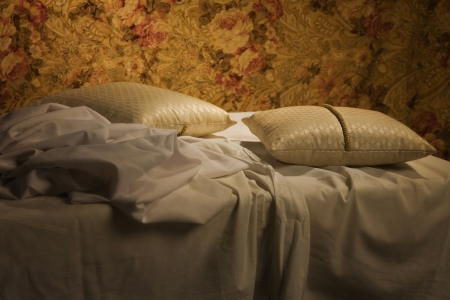 throw cushion: Messy unmade bed with pillow and quilt cover Stock Photo