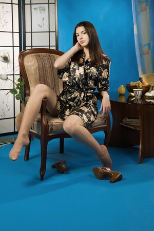Attractive pretty lady sitting in the armchair Stock Photo - 9128288